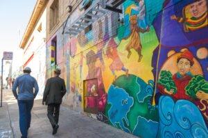War Horse Cities CEO Scott Plank and Del Seymour walk through the Tenderloin in San Francisco.